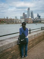 A girl gazing at the city skyline from London's South Bank.