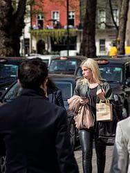 A lady walking in Berkley Square London